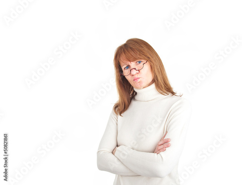 Woman with reading glasses looking doubtfully into the camera