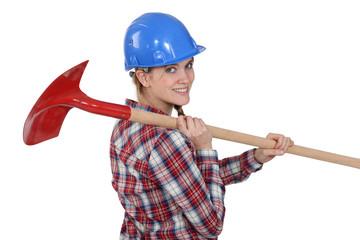 Woman carrying spade