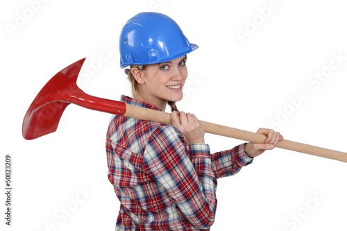 Woman carrying spade