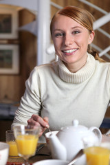 Smiling woman at the breakfast table