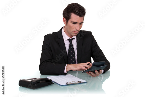 Worker using calculator