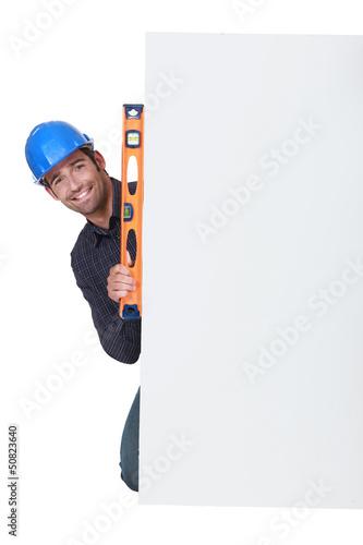 Workman with a spirit level