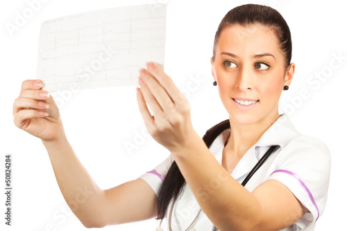 woman doctor is looking cardiogram