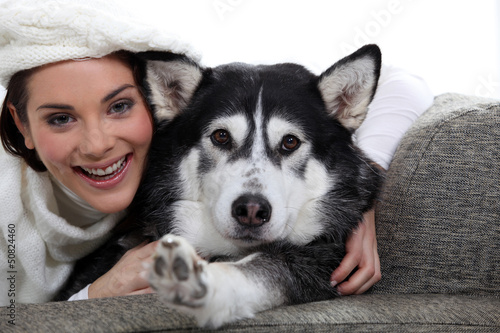 Woman with her dog on a sofa