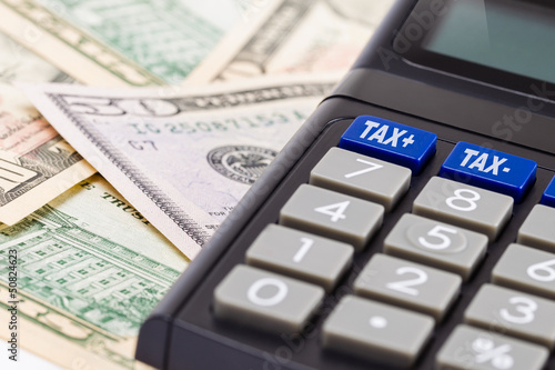 Tax Calculator and dollar bills