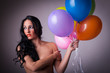 sexy brunette woman holding balloons