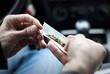 man making joint and a stash of marijuana in the car - 50825081