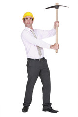 full-body portrait of architect holding pickaxe
