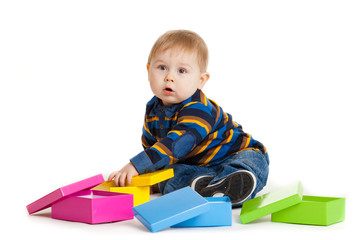 baby boy and gift box isolated on white.  Portrait of happy beau