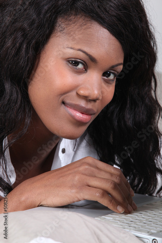 a black woman doing computer