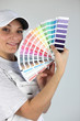 Female decorator with paint swatch