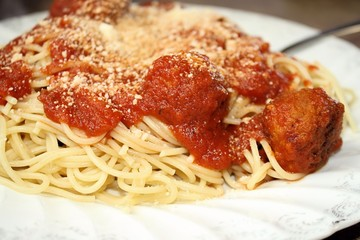 Pasta with meatballs, tomato sauce and grated Parmesan Cheese