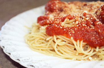 Pasta with tomato sauce, meatballs and grated Parmesan cheese