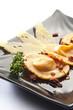 raviolone con pomodorini secchi e formaggio