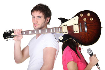 Young couple with a guitar and microphone