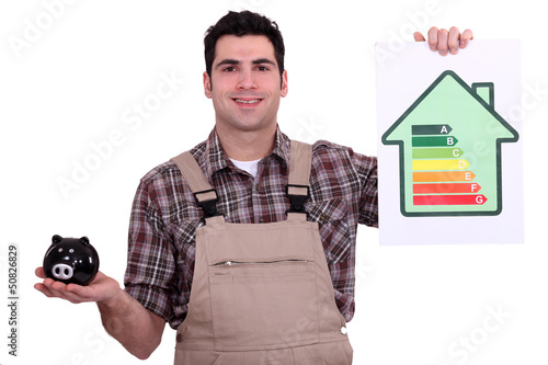 Man holding piggy bank and chart of energy consumption