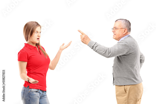 Angry father reprimanding his teenage daughter