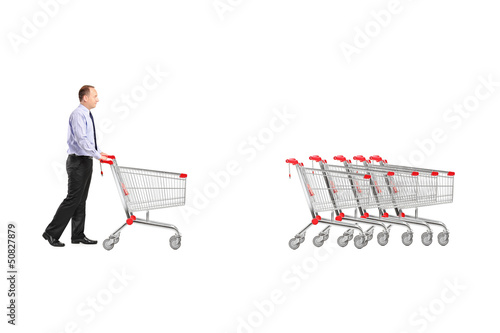 Full length portrait of a man returning an empty shopping cart