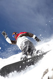Snowboarder spraying powder