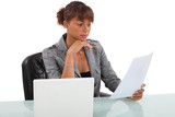 Woman carefully reading through document