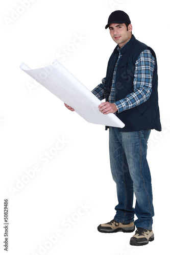 Man holding construction plans