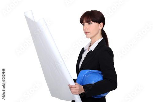 Female architect examining plans