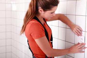 Woman fitting plug