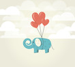 Heart balloons lifting up green elephant.Power of Love concept.
