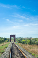 Summer landscape with small railroad bridge in Ukraine.