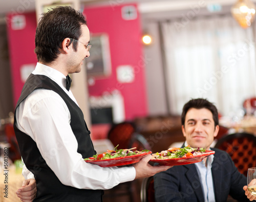 Waiter serving in a restaurant