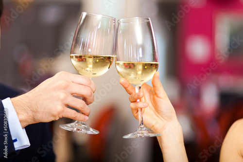 Couple toasting wine