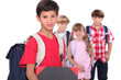 Four young schoolchildren