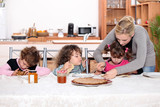Young children eating crepes
