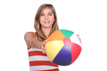 studio shot of young blonde with mutlicoloured balloon