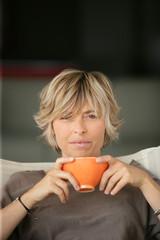 woman drinking tea on the sofa