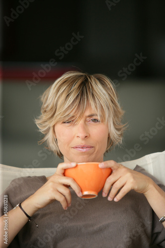 woman drinking tea on the sofa
