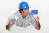craftsman holding european flag and bank notes