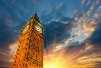 London, Wonderful upward view of Big Ben Tower and Clock at suns