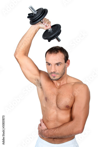 bare-chested man muscular man doing fitness with dumbbell