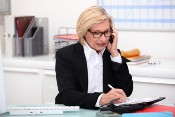 Woman on the phone in her office