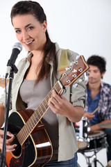 Woman with acoustic guitar