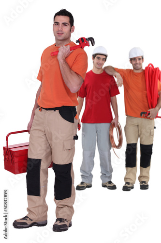 Three plumbers ready to work