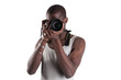 Young african man holding camera over white background.