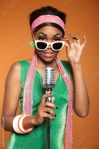 Vintage soul funk woman singing. Black african american.