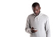 Young african man using mobile phone over white background.