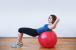 Young woman exercise with ball in the gym.