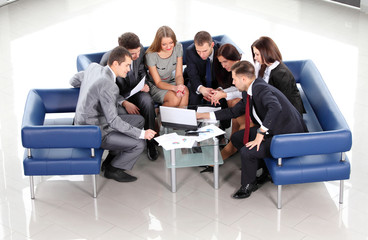 Top view of working business group during meeting