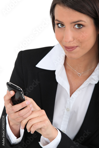 Woman dialing a phone nulmber