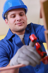 Tradesman using a tool