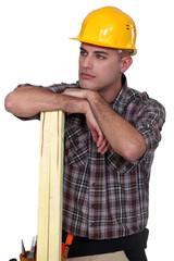 A pensive carpenter.